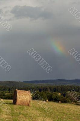 overcast sky with rainbow