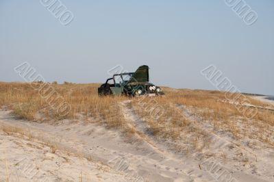 Car broken in sands.