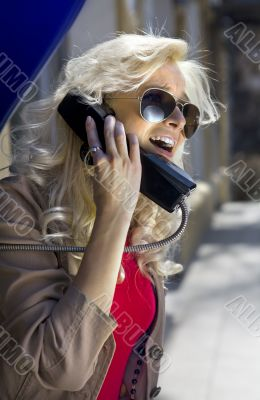 blonde with phone handset
