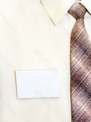 blank badge pinned to his shirt