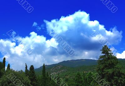 white clouds over the mountains