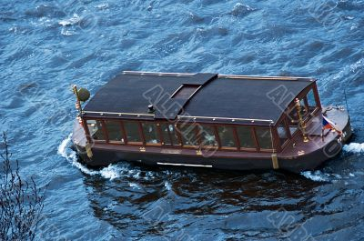 Touristic ship on the river Vltava in Prague