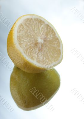 Half of a lemon on mirror