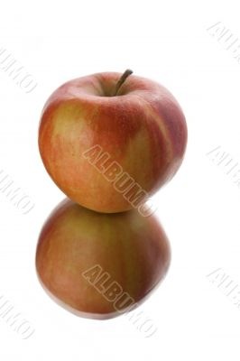 Red apple on white background. Reflection.