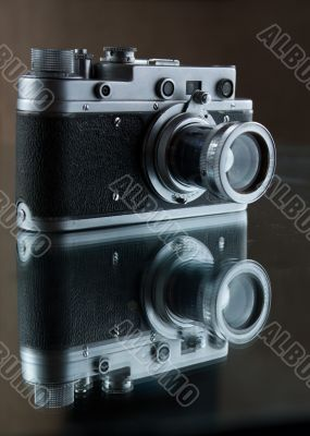 Old rangefinder camera. Reflection.