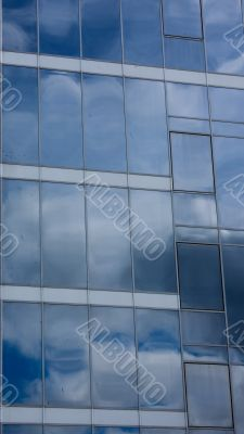Sky and clouds reflected in modern window
