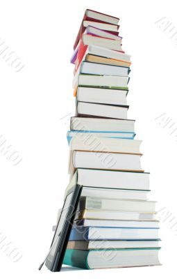 Tall stack of books and e-book reader