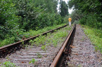 Walking Away Down Abandoned Railroad Track