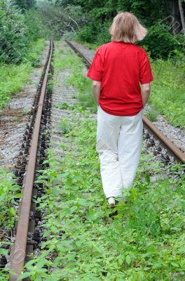 Walking Away Along Abandoned Railroad Track