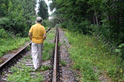 Walking Away Down Railroad Track