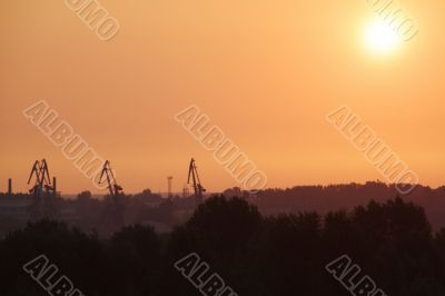 Sunrise over the cargo cranes
