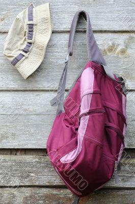 Khaki Hat and Purple Backpack