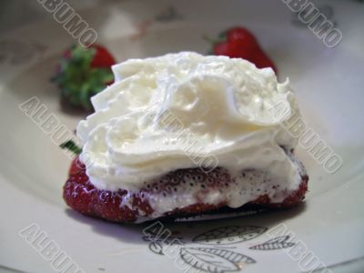 Strawberries and cream on the plate