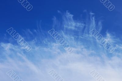 Easy crests of white clouds