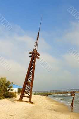 Metal tilted tower on the coast