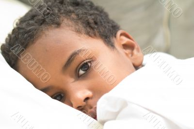 Boy resting in his bed