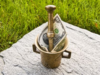 Mortar with dollar of green grass and stone