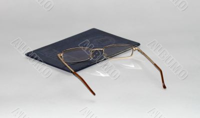 diploma of education and glasses