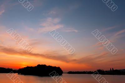 Multicolour cloudscape over reservoir