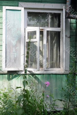 Open Window of Shabby Country House