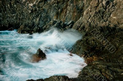 waves roll over the rocks