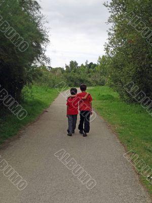 two boys walking along a path