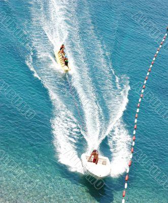 Motor-boat with banana boat water sled