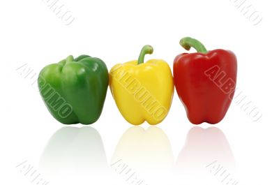 Green, Red And Yellow Capsicum In A Row