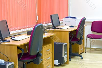 office interior with two jobs