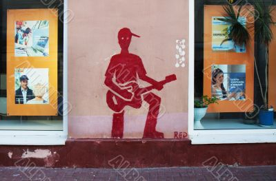 Drawing on a wall - the red guitarist