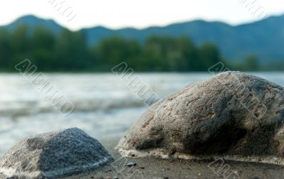 Stones on the mountain river shore