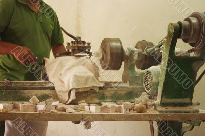 Craftsman using grinder in workshop