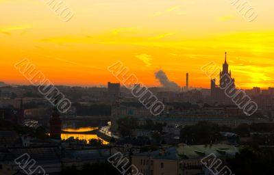 Moscow city sunrise. Kremlin, river and skyline
