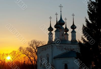Russian church domes on sunset. Early spring.