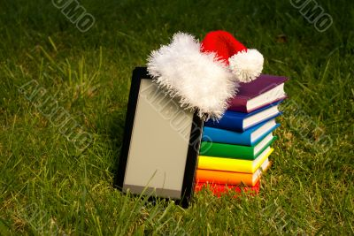 Electronic book reader with Santa`s hat