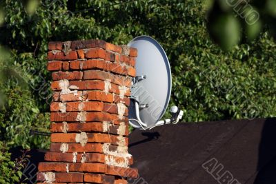 Brick chimney and satellite communication tv