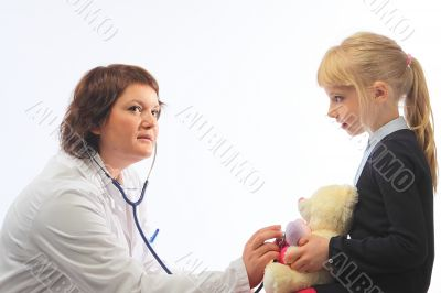 The woman the doctor with the little girl