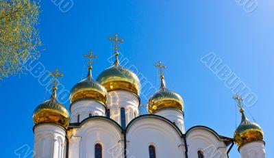 Russian othodox golden domes on sunshine