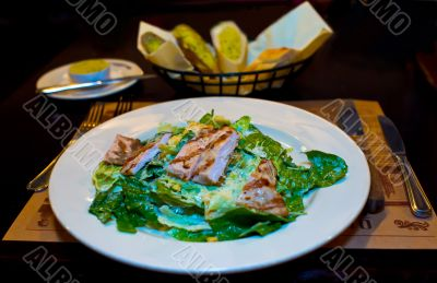 Ceasar salad on served table