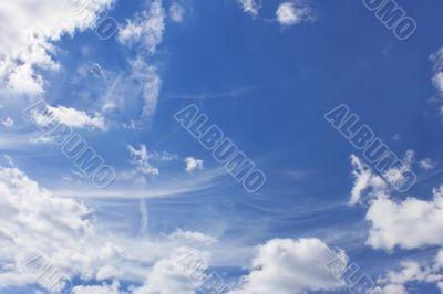 Clouds around blue sky