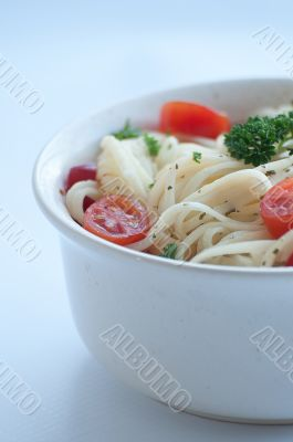 Angel hair pasta with tomato and parsley