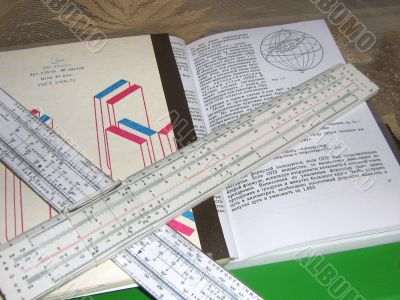 Still life with a book and two slide rules.