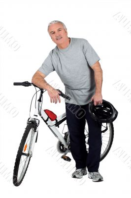 a mature man and a mountain bike