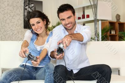 A couple having fun playing video games