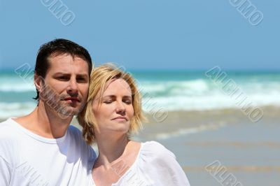 Couple stood together on a  beach