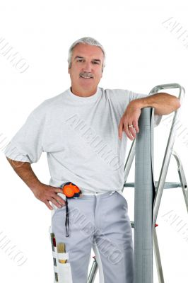 Middle-aged man with ladder and roll of wallpaper