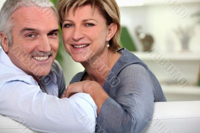 Smiling couple sitting on a sofa