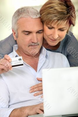 Couple making purchases on the Internet