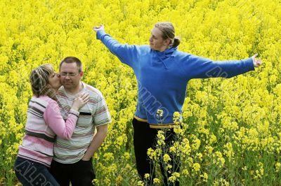Three people in meadow