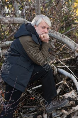 Middle-aged man in forest.